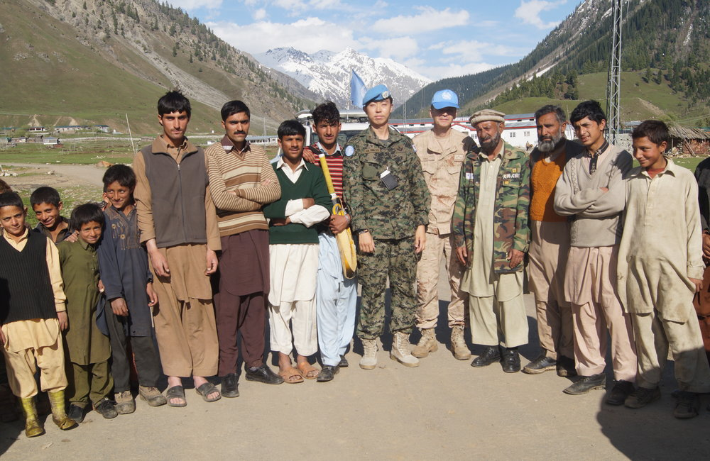 UN Field Station, Gilgit staff Maj D.K. Kim and Capt. Denis Zubac with local populations in  Minimarg.  (16 May, 2016, Gilgit, Pakistan)