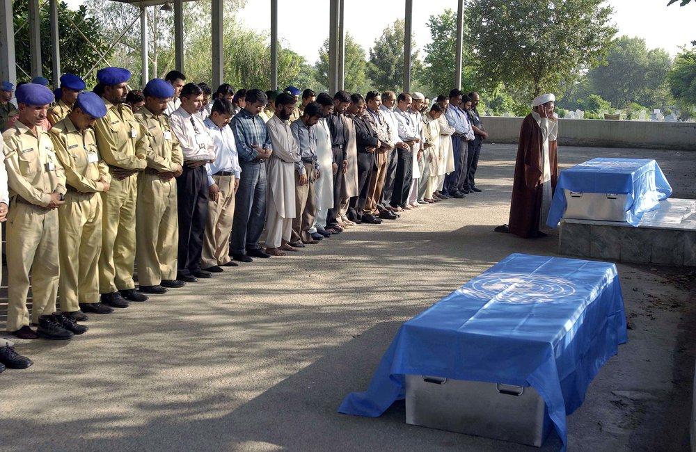 Military staff of UNMOGIP and other mourners at the burial of Firas Al-Hayali and his seven-year old son, Hussain Al-Hayali, today in Islamabad. The 33-year old Al-Hayali, an IT Network Administrator with UNMOGIP, and his son were killed when the Margala Towers building complex they were in collapsed during the 7.6 magnitude quake that struck northern Pakistan on 8 October. Mr. Al-Hayali was a national of Iraq. (17 October, 2005, Islamabad, Pakistan)
