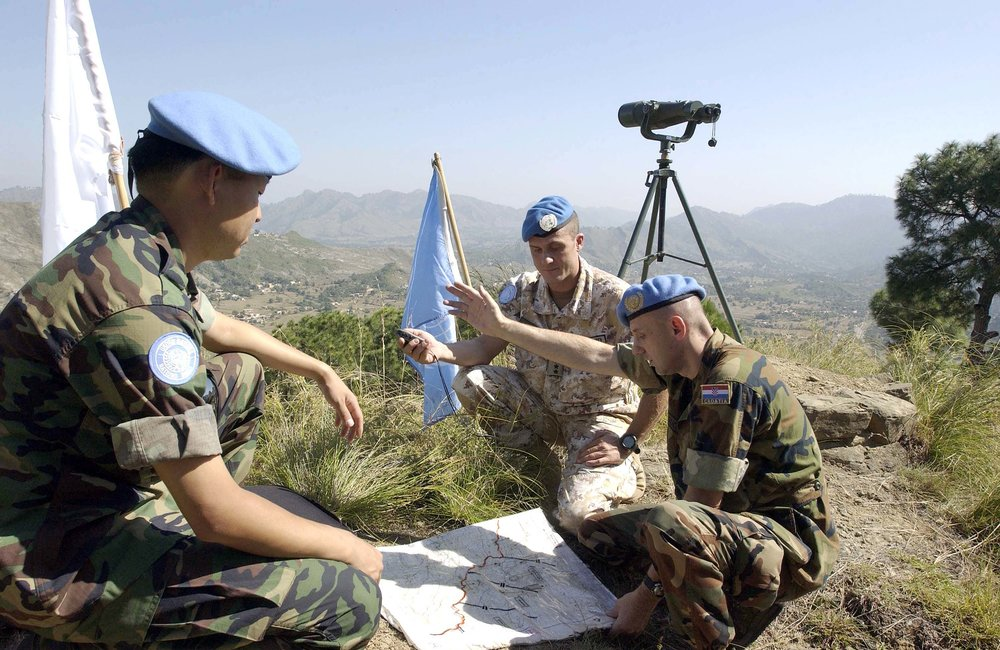 Peacekeepers UNMOGIP are pictured here going over their plans for the day in observing the Line of Control that separates the two Countries, today near Bhimbar UN Field Station, Pakistan. (20 October, 2005, Pakistan)